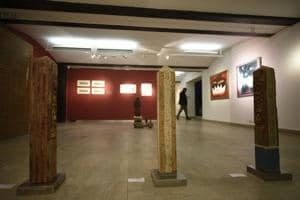 A section of the display from Benevolent Gaze: Buddhist Imprints in Art, an ongoing exhibition at Ojas Art gallery. The work in the foreground is by Vineet Kacker and titled Spirit Marker.