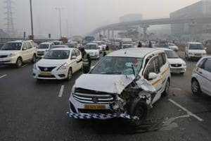 A car gets hit by another near the highway exit point for Cybercity, in Gurgaon. Experts say most accidents in the city happen because of faulty road design.