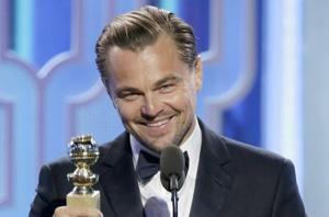 Leonardo DiCaprio accepts the Golden Globe for his performance in The Revenant.