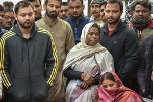 RJD leader Rabri Devi along with her sons Tejashwi Yadav and Tej Pratap at the residence of her husband and party chief Lalu Prasad