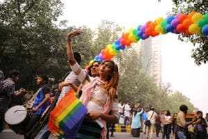 LGBTQ members and supporters, many wearing colourful costumes and holding balloons, participated in Delhi