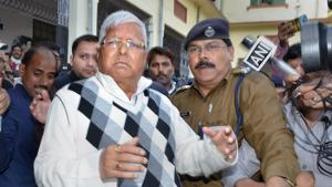 RJD supremo Lalu Prasad Yadav escorted by police officials after being convicted by the special CBI court in fodder scam case, in Ranchi.