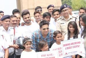 Bollywood actor Sidharth Malhotra joined Delhi Traffic Police and promoted a campaign against drink driving and stunt driving. He is seen here at an event held at India Gate, central Delhi, in 2017.