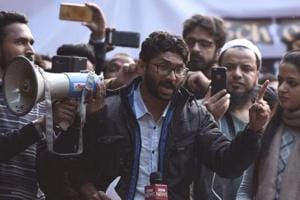 Dalit leader Jignesh Mevani addresses protest rally at Parliament Street in New Delhi on Tuesday.