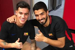 Look away, Liverpool fans! Luis Suarez welcomes Philippe Coutinho to...