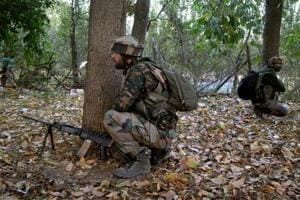 Army personnel take positions during an encounter in Jammu and Kashmir.