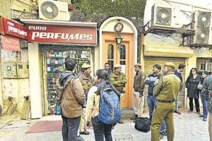 Police and NDMC officials in Khan Market on Tuesday.