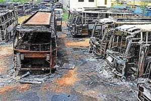 Buses burnt by protesters in Bengaluru during violence on the Cauvery river water issue. (Kashif Masood / HT File Photo)