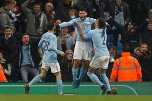 Manchester City's Sergio Aguero heads last-gasp winner in League Cup...
