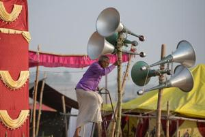 A worker adjusts loudspeakers at a camp during the Magh Mela festival in Allahabad on January 6, 2018. Allahabad has more than 12,000 shrines.