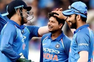 File image of Kuldeep Yadav (C) celebrating the fall of a wicket with his teammates.