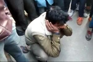 Accused constable Subhash Singh being roughed up by a mob after he allegedly raped a seven-year-old woman in Surajpur in Greater Noida.