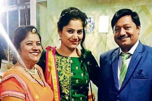 Sanhita, flanked by Geeta and her new father.