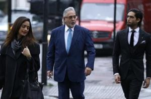 Vijay Mallya (centre) arrives at the Westminster Magistrates' Court as his extradition case continues in London.