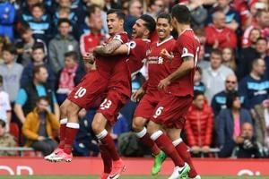 Liverpool, without Philippe Coutinho, out to halt Manchester City in...