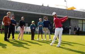 Shubhankar Sharma offers golfing tips to budding players at the DLF Golf and Country Club in Gurgaon on Thursday.
