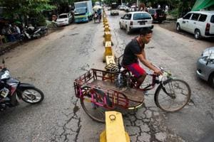 Photos: Myanmar's iconic trishaws unfazed by cars, clogged roads