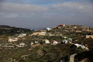 Israel approves more than 1,100 new West Bank settlement homes, says...