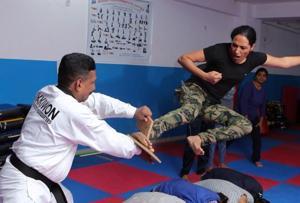 52-year-old Taekwondo champion trains Capital's women cops in...