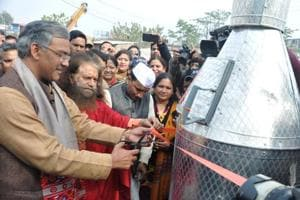 Chief minister launches 'kill waste' device to clean Rispana river
