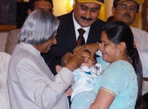 Then President APJ Abdul Kalam administers polio drops to a baby.