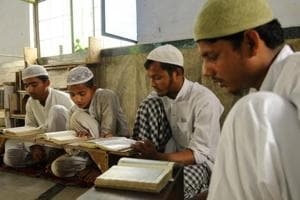 Muslims boys recite Quran at a local madrasa in Noida.