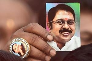 A supporter wears a ring with an image of former chief minister J Jayalalithaa
