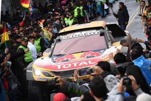 Fans greet Dakar Rally cars segment overall leader, Peugeot