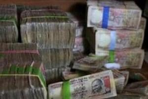 I-T dept seizes Rs 85 crore cash, bullion from illegal Delhi vault in...
