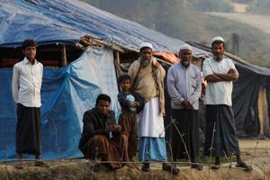 Insurgents say 10 Rohingya found in mass grave were 'innocent...