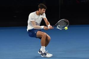 Australian Open tennis: Returning Novak Djokovic still managing elbow...