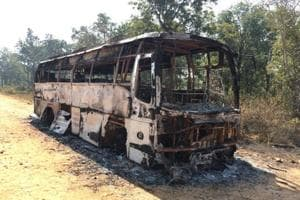 The bus that was torched by Maoists in Bastar region of Chhattisgarh. (HTPhoto)