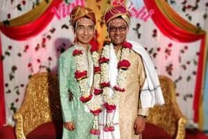 Hrishi Sathawane (right) and hVinh at their marriage in Yavatmal in Maharashtra.