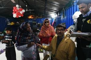 A doctor checks patients at a night shelter near Gurdwara Bangla Sahib.