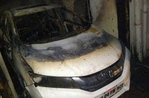 The fire started in the meter box room in the ground floor of Rajhans building and spread to  the cars parked nearby.