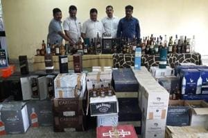 Sleuths of the excise department with the seized liquor.