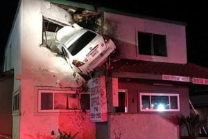 Car crash mystery: Sedan lands on top floor of building in California...