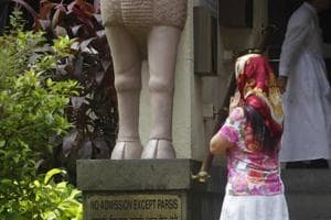 Why does a woman's religious identity in India still depend on who...