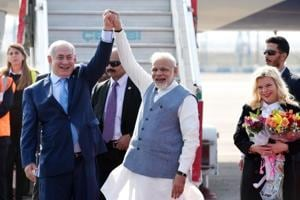 Prime Minister Narendra Modi welcomes Israeli Prime Minister Benjamin Netanyahu and his wife Sara Netanyahu ( r) on their arrival at the Air Force Palam airport Station in New Delhi, India, on Sunday.