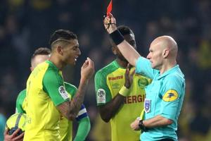 Bizarre! Referee kicks Nantes player, sends him off as Paris...