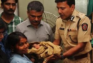 The newborn was returned to his mother on Monday.