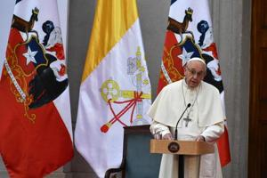 Pope Francis addresses political authorities at La Moneda Presidential Palace in Santiago on January 16, 2018. The pope landed in Santiago late Monday on his first visit to Chile since becoming pope, and his sixth to Latin America .