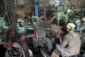 File photo of workers making gear parts for cranes inside a workshop in Mumbai.