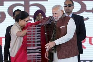 Chief minister Vasundhara Raje felicitates Prime Minister Narendra Modi during the work commencement of refinery project at Pachpadra in Barmer on Tuesday.