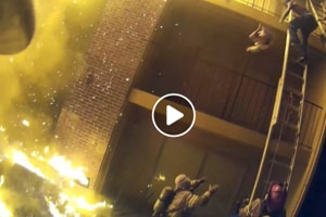 Dramatic footage shows a fireman catching a baby thrown from a burning building (Dekalb County fire rescue department/Facebook)