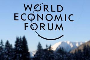 This file photo shows the logo of the World Economic Forum on the third day of the forum