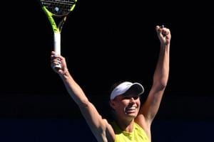 Caroline Wozniacki fights back from brink to beat Jana Fett in...
