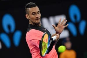 Nick Kyrgios deals with distractions to down Viktor Troicki in...