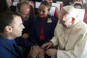 Made in heaven: Pope performs first marriage on board a papal flight