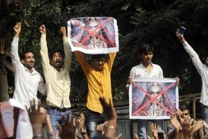 Members of a Karni Sena display posters and shout slogans against the release of Padmaavat near the office of CBFC in Mumbai on Friday, January 12.